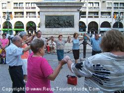 Locals Dancing In The Street During The San Pere Fiesta In Reus